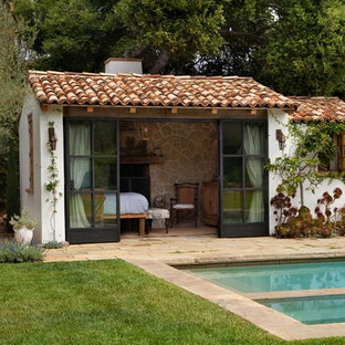Photo of a mediterranean back rectangular swimming pool in Santa Barbara with a pool house.