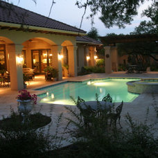 Mediterranean Patio by John Pack Custom Pools