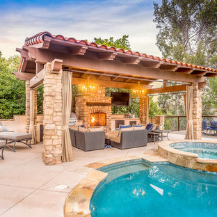 Mid-sized tuscan backyard round hot tub photo in Los Angeles