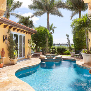 Inspiration for a mediterranean custom-shaped pool remodel in Charlotte