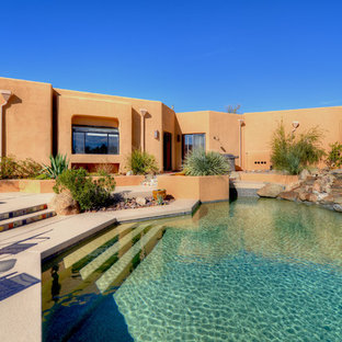 Inspiration for a southwestern custom-shaped pool remodel in Phoenix