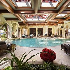 Mediterranean Pool by Clifford M. Scholz Architects Inc.