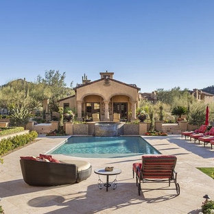 Large tuscan backyard stone and rectangular pool house photo in Phoenix