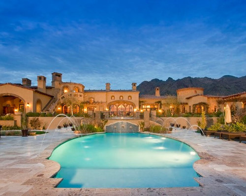 inspiration for a huge mediterranean backyard concrete paver and custom shaped natural pool fountain remodel