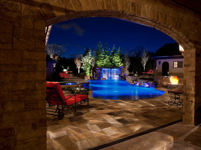Mediterranean Pool by CAVINESS LANDSCAPE DESIGN, INC.