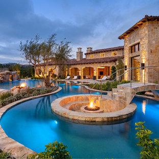 Tuscan custom-shaped water slide photo in San Diego