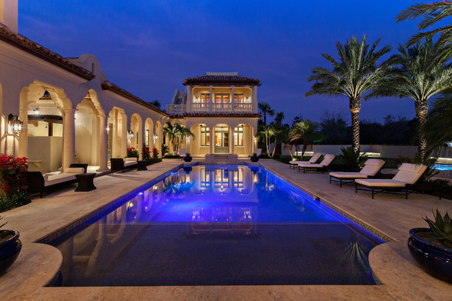 Mediterranean Pool by Village Architects AIA, Inc.