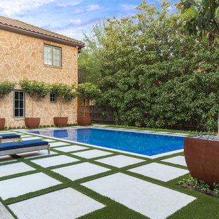 Example of a tuscan backyard rectangular and concrete paver pool design in Dallas