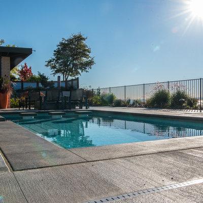 Mid-sized 1950s backyard rectangular pool photo in Seattle
