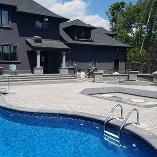Inspiration for a large backyard concrete paver and custom-shaped natural pool remodel in Boston