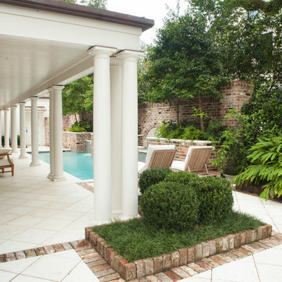 Inspiration for a mid-sized mediterranean backyard stamped concrete and rectangular lap pool fountain remodel in Miami