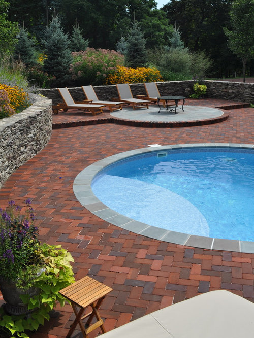 Round pool design ideas remodels photos with brick pavers for Pool design houzz