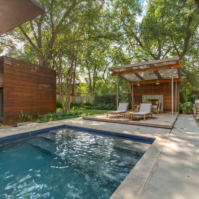 Trendy pool photo in Dallas with decking