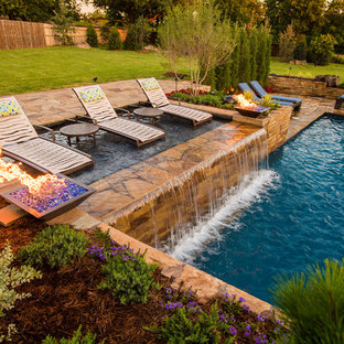 Inspiration for a mid-sized modern backyard stone and rectangular lap pool fountain remodel in Oklahoma City