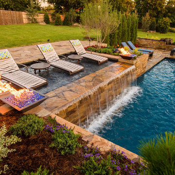 Modern Geometric Pool with Fire Features and Sun Shelf