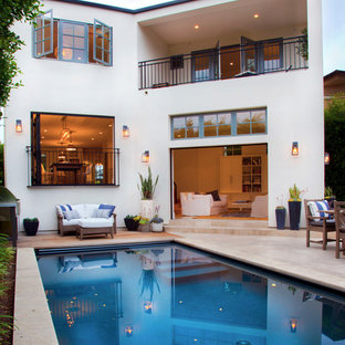 Example of a transitional backyard rectangular pool design in San Diego