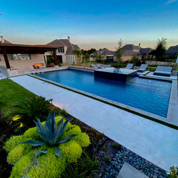 Modern Hillside Pool with Fire and Water Features
