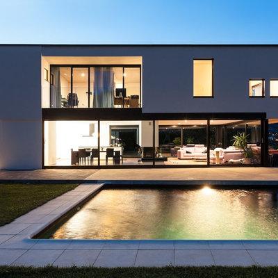 Pool - mid-sized contemporary backyard rectangular lap pool idea in Toronto