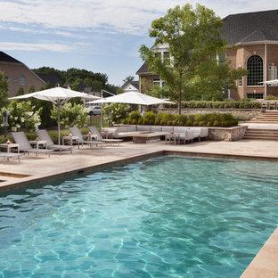 Large elegant backyard stone and rectangular lap pool photo in DC Metro