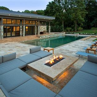 Pool - large traditional backyard stone pool idea in DC Metro