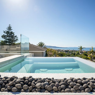Pool - large contemporary rooftop stone and rectangular pool idea in Los Angeles