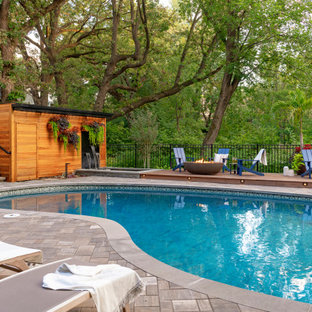 Example of a mid-sized trendy backyard stone pool design in Minneapolis