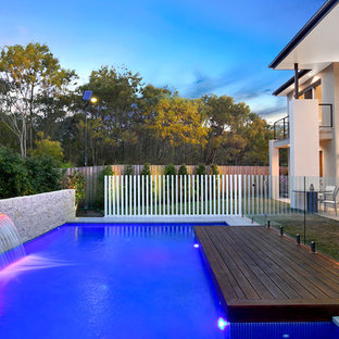 Example of a trendy pool design in Sydney with decking