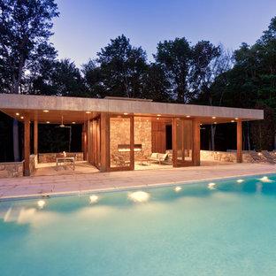 Minimalist rectangular pool house photo in New York