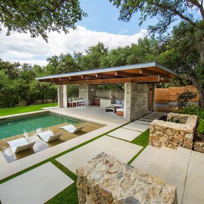 Large minimalist backyard stone and rectangular pool house photo in Austin
