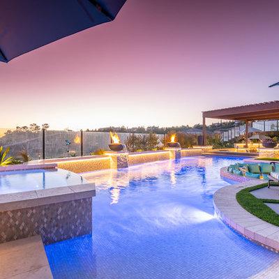 Hot tub - large contemporary backyard tile and custom-shaped lap hot tub idea in Orange County