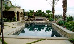 modern tuscan dramatic pool, outdoor living room,