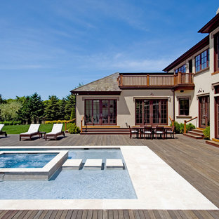 Inspiration for a timeless pool remodel in New York with decking