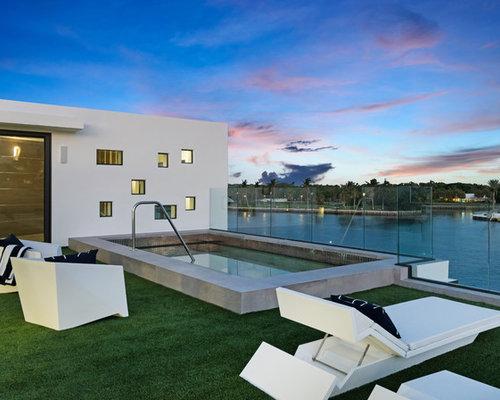 Example Of A Minimalist Backyard Rectangular Lap Pool Design In Miami