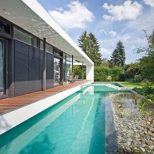Idee per una grande piscina monocorsia contemporanea personalizzata