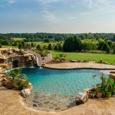 Inspiration for a huge rustic backyard stamped concrete and custom-shaped natural water slide remodel in Atlanta