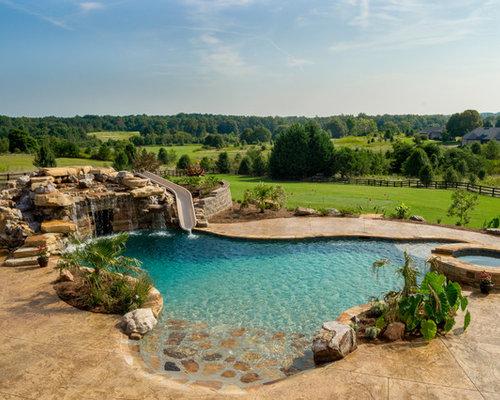 Fotos de piscinas dise os de piscinas con tobog n for Piscinas rusticas fotos