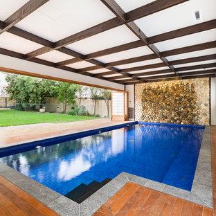 Imagen de piscina alargada, de estilo zen, grande, interior y rectangular, con entablado