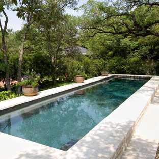 Inspiration for a large timeless backyard rectangular lap pool remodel in Austin