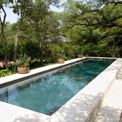 Inspiration for a large timeless backyard rectangular lap pool remodel in Austin