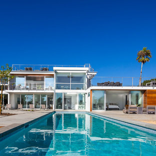 Example of a trendy backyard concrete paver and rectangular lap pool design in Los Angeles