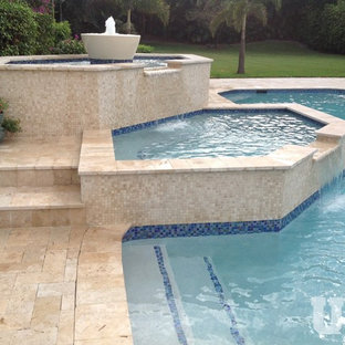 Design ideas for a large country aboveground pool in Miami with natural stone pavers.