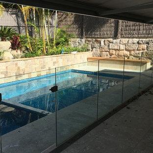 Ejemplo de piscina minimalista en patio trasero