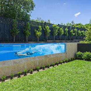 Design ideas for a modern backyard rectangular lap pool in Melbourne.