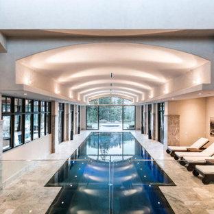 Ejemplo de casa de la piscina y piscina tradicional renovada, extra grande, interior y rectangular, con adoquines de piedra natural