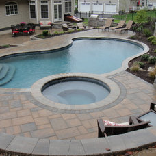 Traditional Pool by Clarke Landscapes LLC