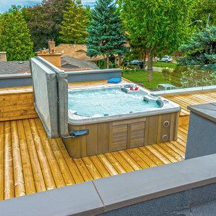 Modelo de piscinas y jacuzzis minimalistas, de tamaño medio, en azotea, con entablado
