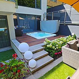 Minimalist backyard hot tub photo in Toronto with decking