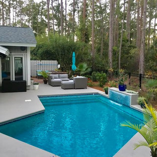 Mid-sized transitional backyard l-shaped lap pool in Atlanta with a water feature and decomposed granite.