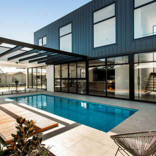 Contemporary side yard rectangular pool in Adelaide.