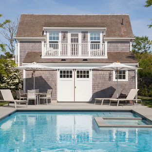Inspiration for a large beach style rectangular pool in Boston with a pool house.